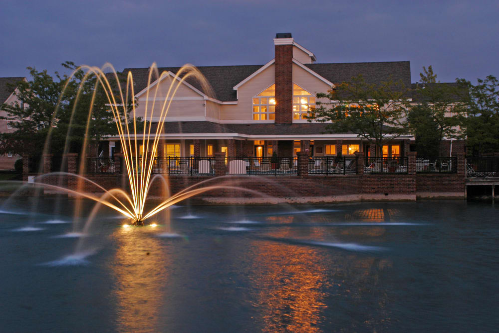 Clubhouse exterior at night with fountain lit up in foreground at Britton Woods in Dublin, Ohio
