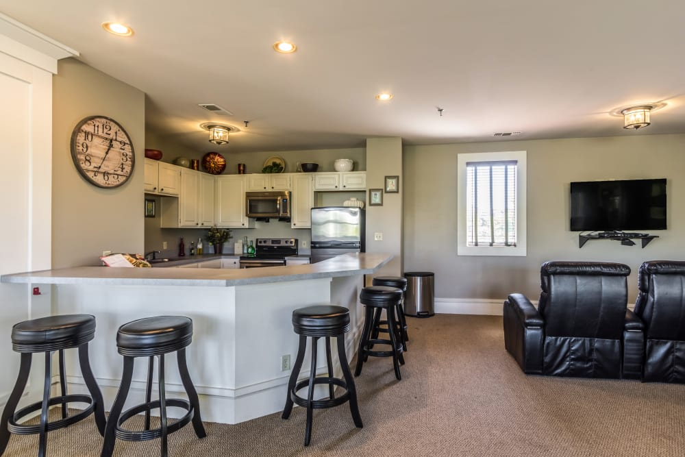 Comfortable leather chairs by kitchen area at Britton Woods in Dublin, Ohio