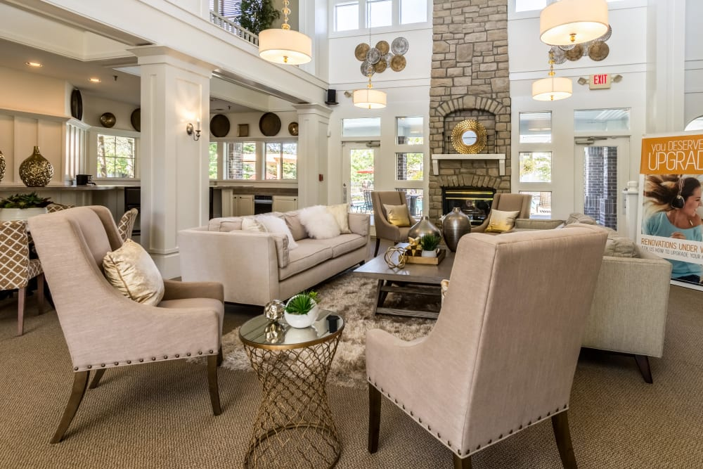 Beautiful clubhouse interior features a sitting area and high ceilings at Britton Woods in Dublin, Ohio