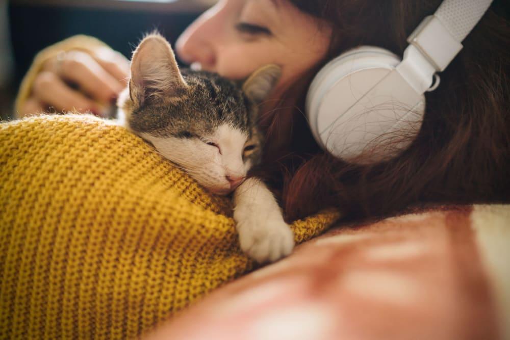 Resident cuddling with a kitten at UNCOMMON Auburn in Auburn, Alabama