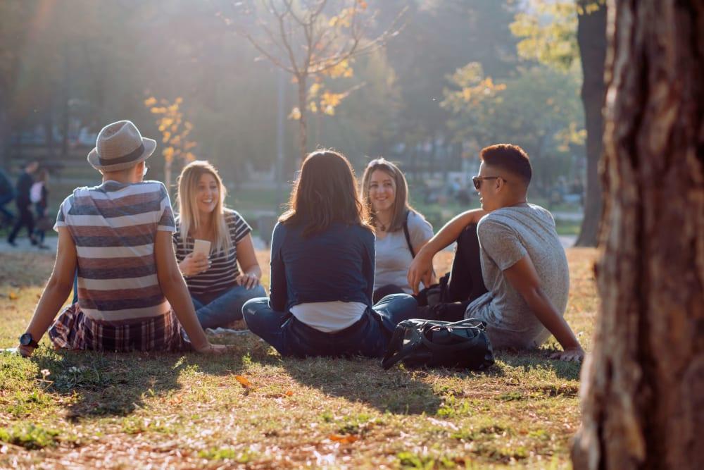 Friends having a picnic at UNCOMMON Auburn in Auburn, Alabama