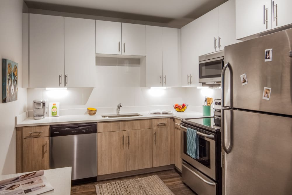 Sleek, fully equipped kitchen at UNCOMMON Fort Collins in Fort Collins, Colorado