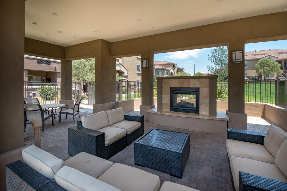Outdoor seating area with fire pit and comfortable couches at Broadstone Towne Center in Albuquerque, New Mexico