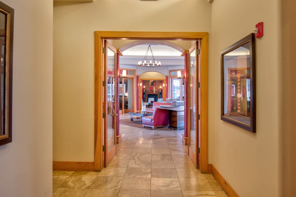 View of clubhouse lobby from hallway with art on the walls at Broadstone Towne Center in Albuquerque, New Mexico
