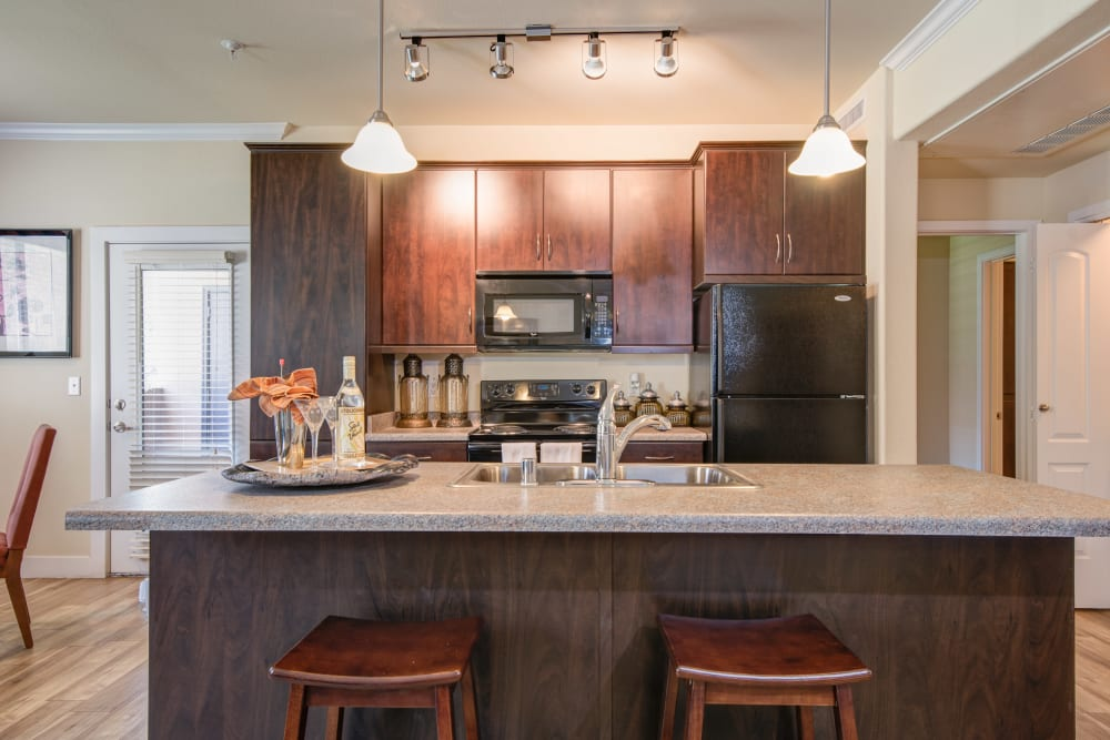 Breakfast bar seating is a feature of this kitchen at Broadstone Towne Center in Albuquerque, New Mexico