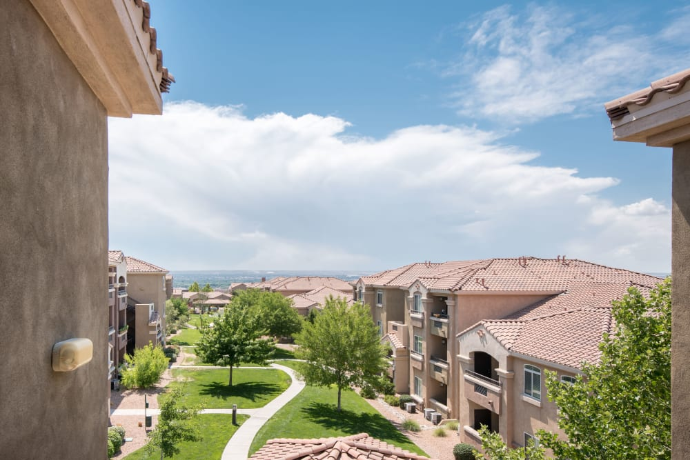 Exterior image of the apartments at Broadstone Towne Center in Albuquerque, New Mexico with blue sky and clouds