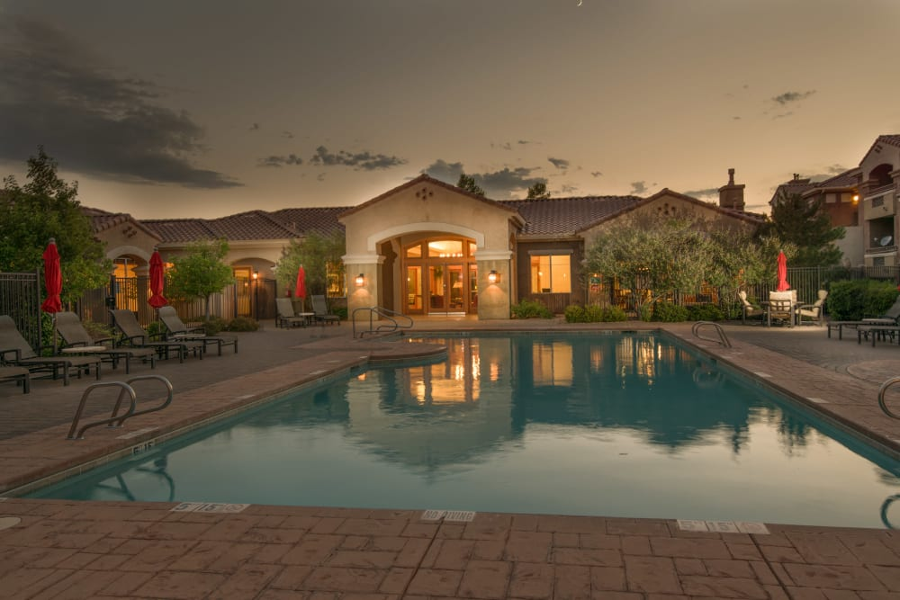 Beautiful evening image of the clubhouse at Broadstone Towne Center in Albuquerque, New Mexico with community pool in the foreground
