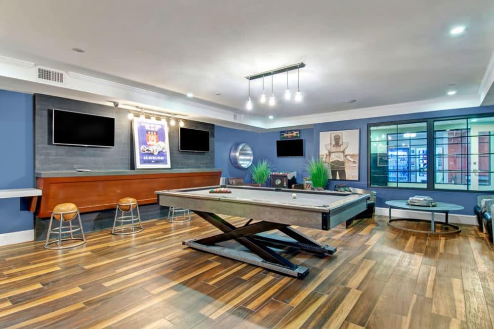 Billiards table in Clubhouse featuring Hardwood floors at Bradlee Danvers in Danvers, Massachusetts