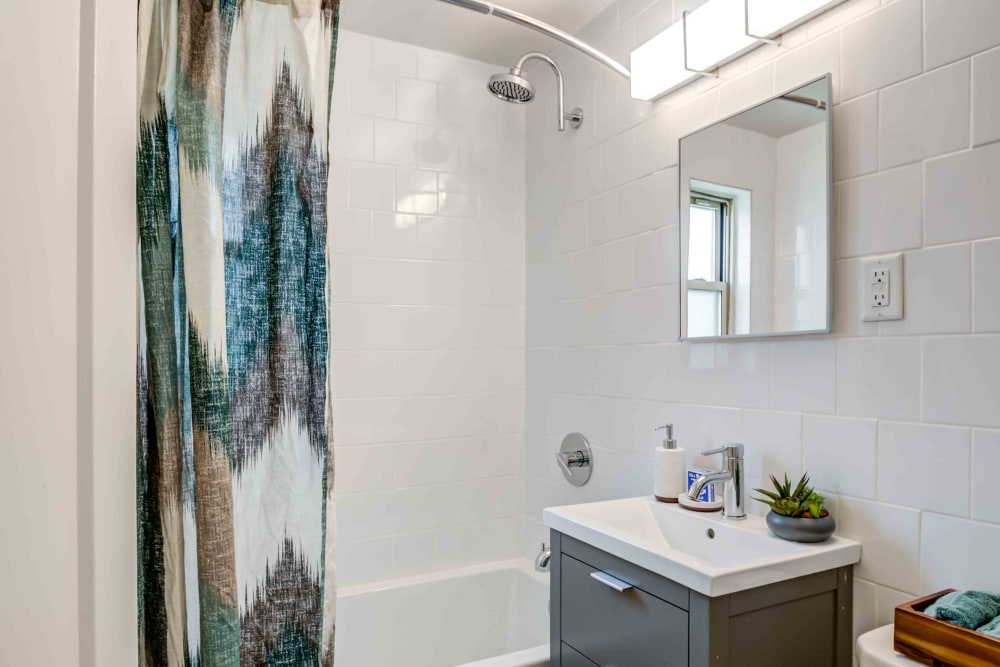 Bathroom with shower bathtub at Haven New Providence in New Providence, New Jersey