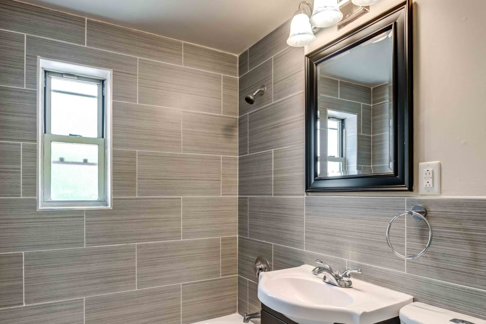 Beautifully tiled bathroom at Haven New Providence in New Providence, New Jersey