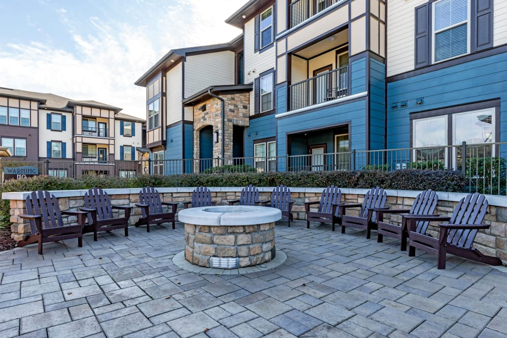 Poolside fire pit with comfortable seating at The Addison at South Tryon in Charlotte, North Carolina