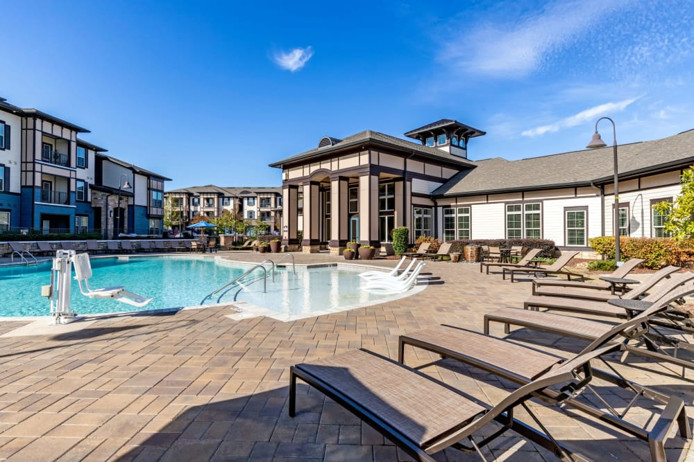 Swimming pool with plenty of comfortable lounge chairs at The Addison at South Tryon in Charlotte, North Carolina