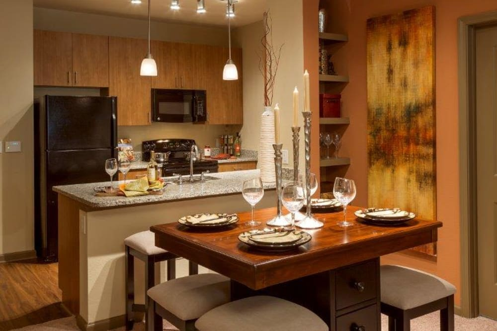 Kitchen with a breakfast bar at The Addison at South Tryon in Charlotte, North Carolina