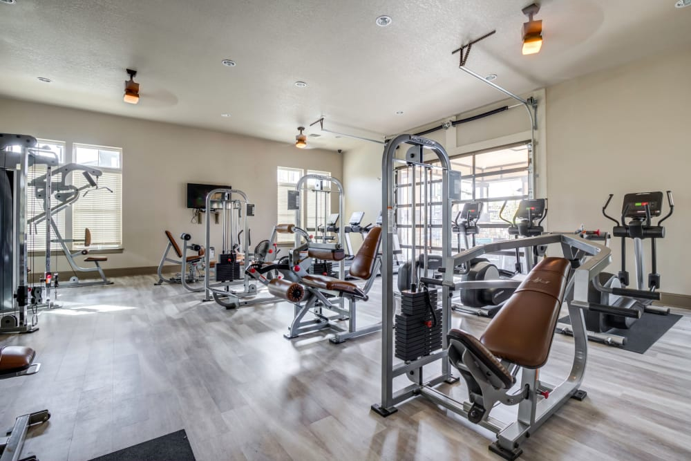 Fitness center with individual workout stations at The Addison at South Tryon in Charlotte, North Carolina
