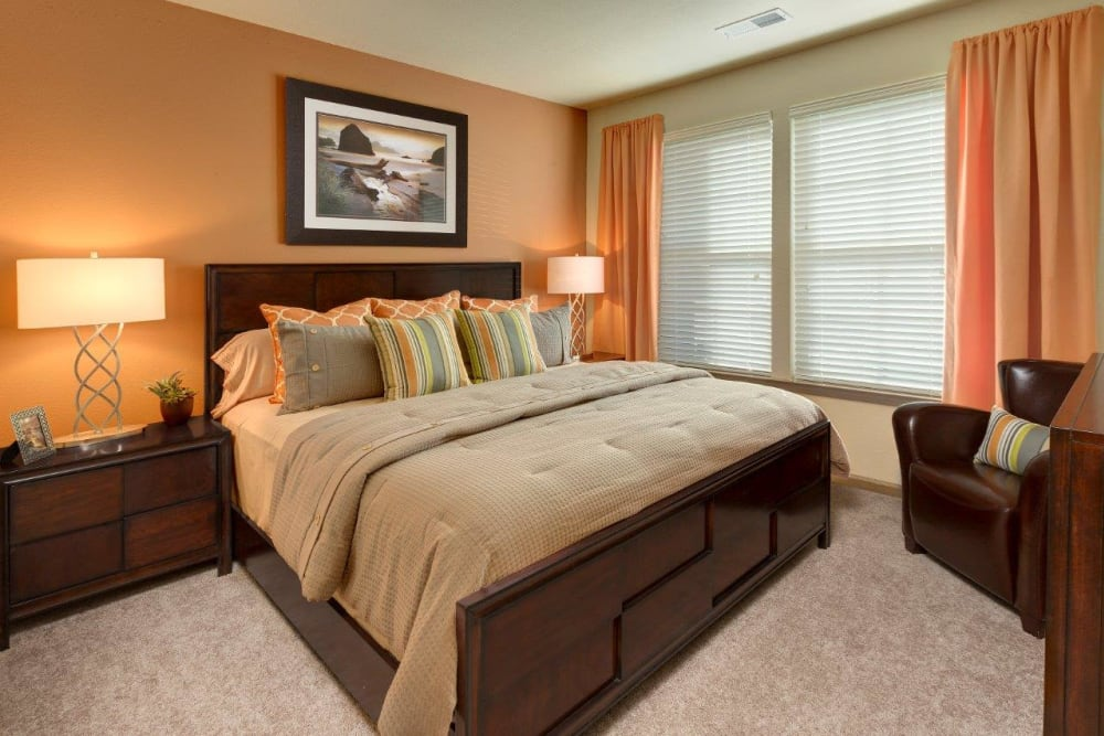 Main bedroom with a large window at The Addison at South Tryon in Charlotte, North Carolina