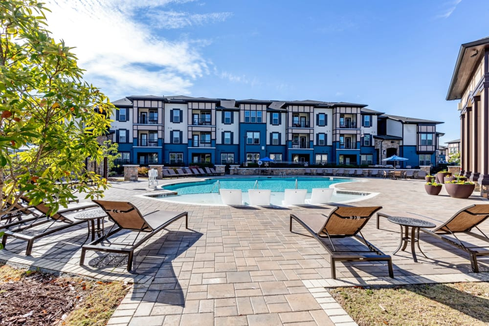 Luxury swimming pool with a large sundeck at The Addison at South Tryon in Charlotte, North Carolina