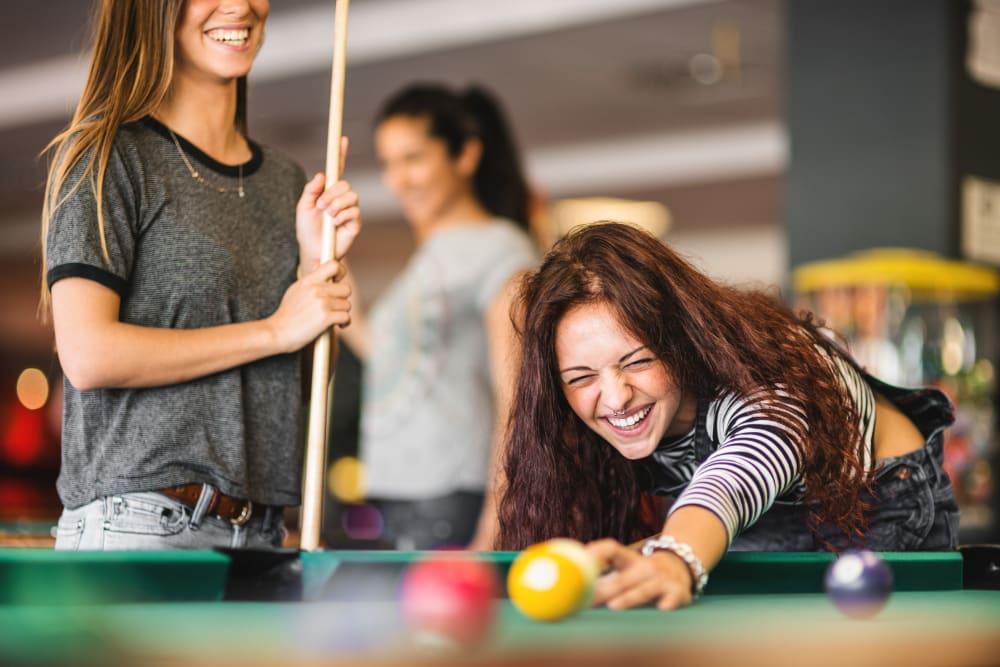 Residents playing billiards in Bloomington, Indiana near evolve Bloomington