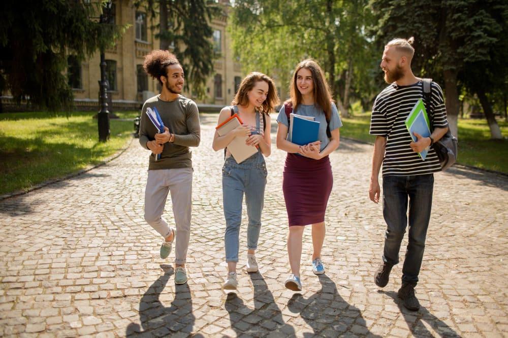 Friends walking through campus near evolve Bloomington in Bloomington, Indiana