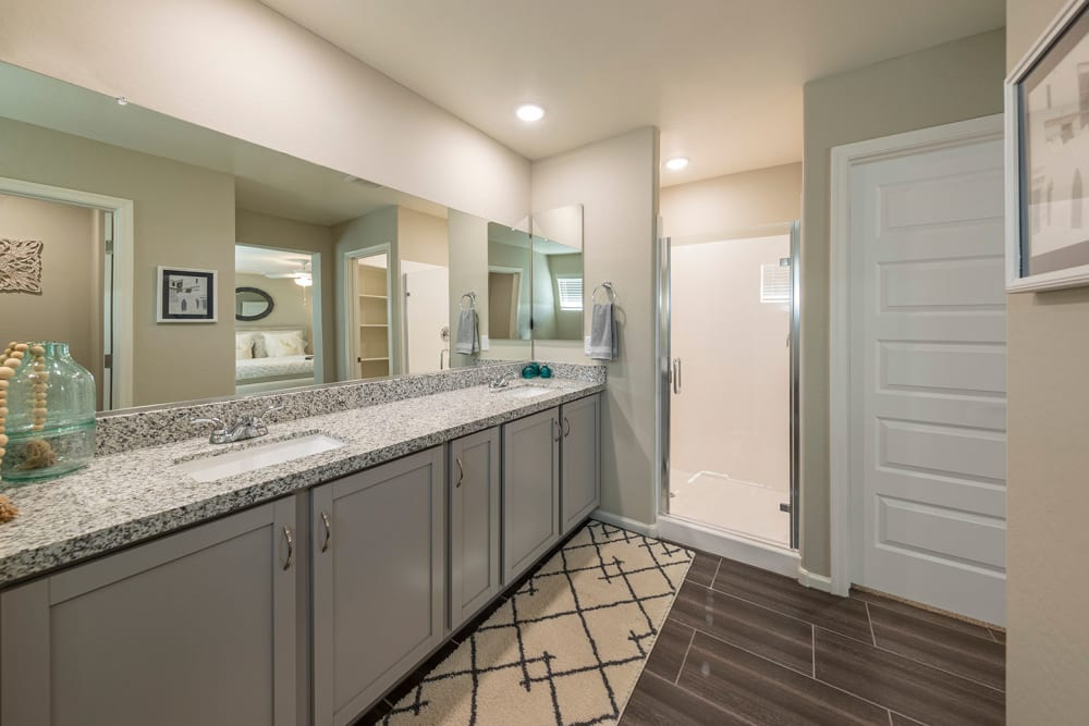 Upgraded luxury bathroom with a large vanity  mirror at BB Living at Eastmark in Mesa, Arizona