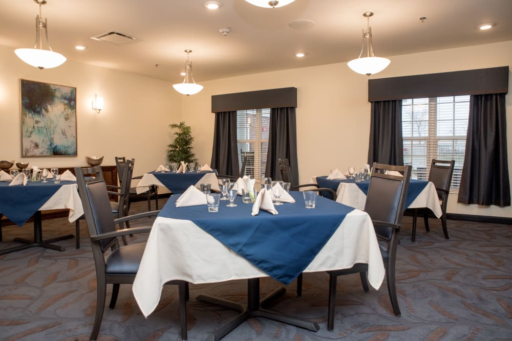 Dining room with square tables and space for wheelchairs at Gateway Springs Health Campus in Fairfield Township, Ohio