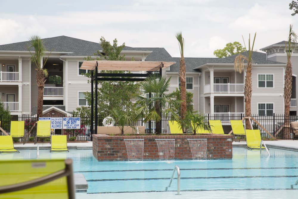 Swimming pool with fountains at Ansley Commons Apartment Homes in Ladson, South Carolina