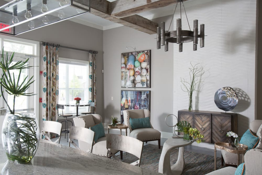 Clubhouse lounge with plenty of seating at Ansley Commons Apartment Homes in Ladson, South Carolina