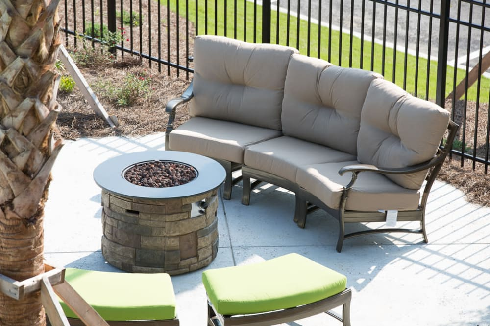 Comfortable seating around a fire pit at Ansley Commons Apartment Homes in Ladson, South Carolina