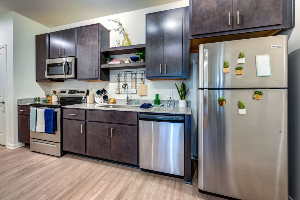 Kitchen with stainless steel appliances at LATITUDE at Kent in Kent, Ohio