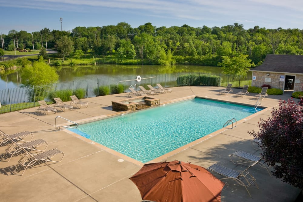 Swimming pool with plenty of lounge chairs at Timber Lakes Apartment Homes in Kansas City, Missouri
