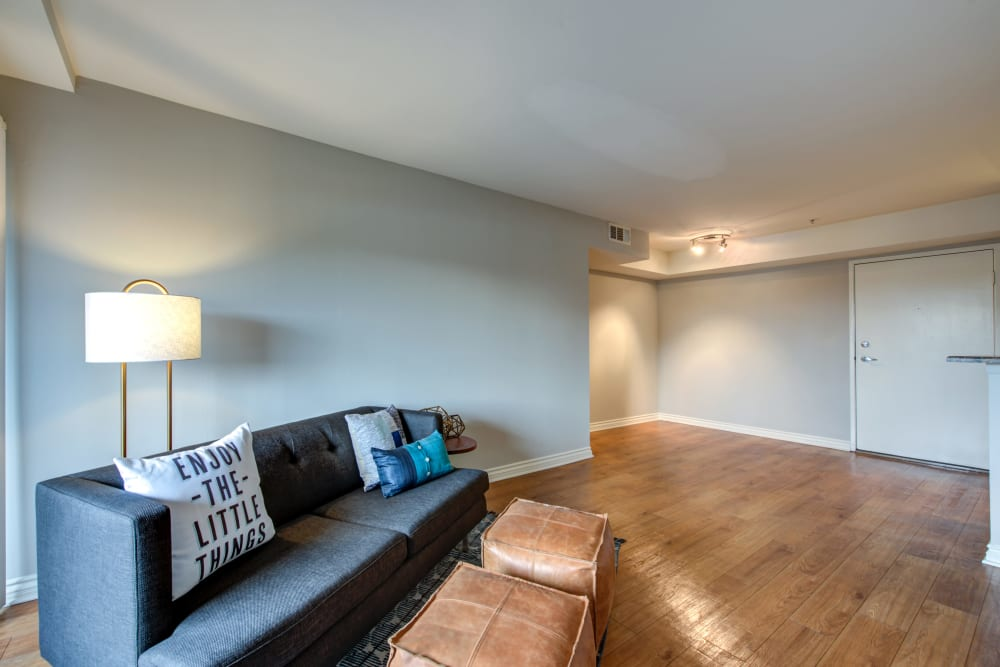 A large apartment living room with hardwood floors at Vue at Laurel Canyon in Valley Village, California