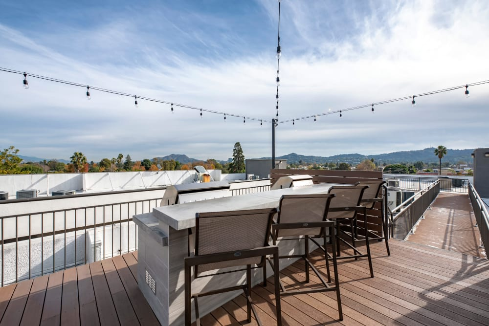 A large balcony area with bar and chairs at Vue at Laurel Canyon in Valley Village, California