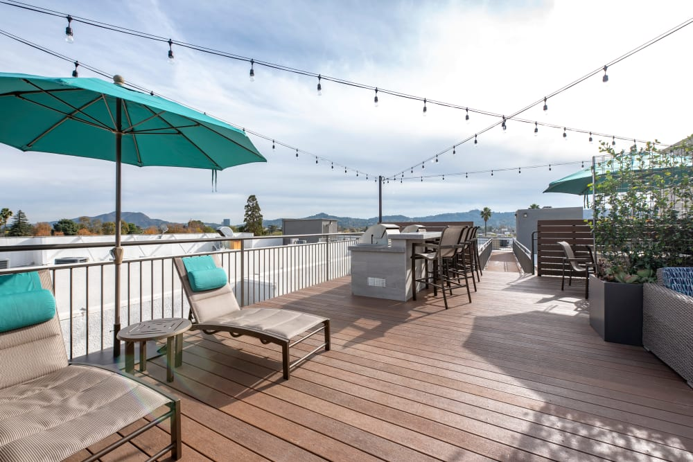 A large wooden balcony with lounge chairs at Vue at Laurel Canyon in Valley Village, California