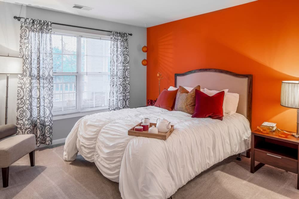 Well lit model bedroom at Sussex at Kingstowne in Alexandria, Virginia