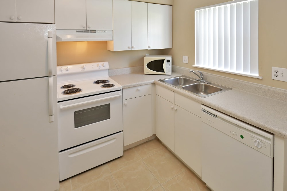 Modern kitchen with white wood cabinets at Stonewood Townhomes in Melbourne, Florida