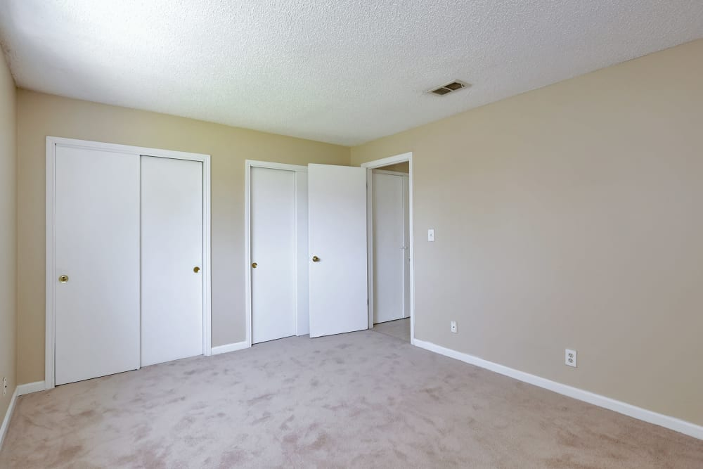 Well lit model bedroom at Stonewood Townhomes in Melbourne, Florida