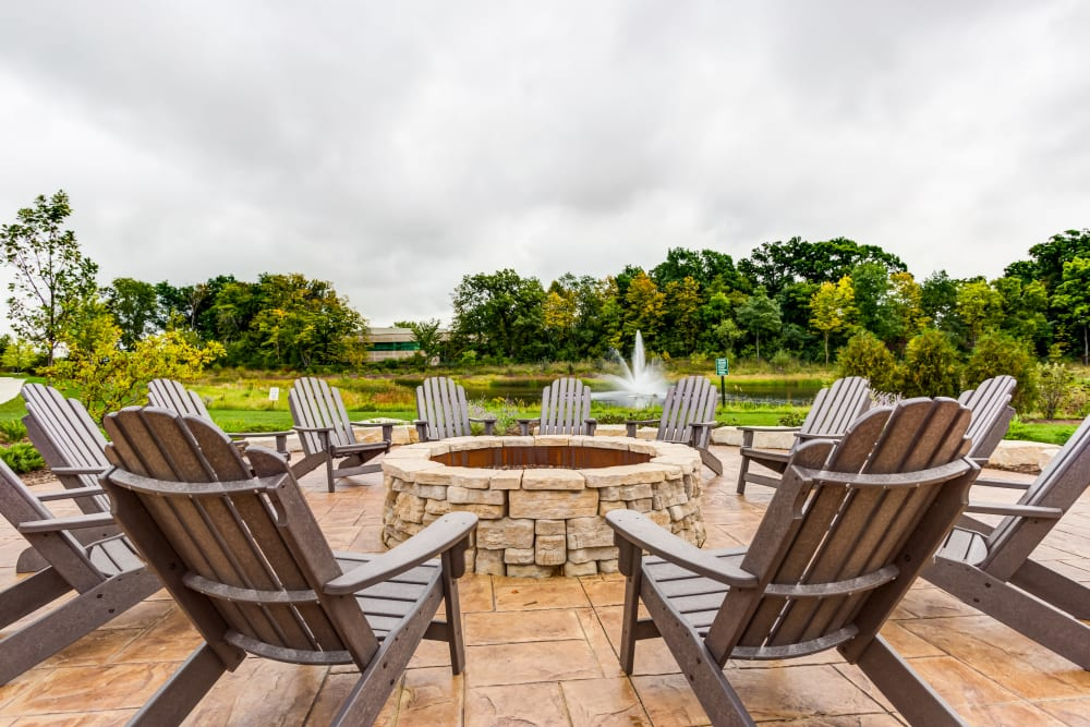 Fire pit with chairs at The Oaks Of Vernon Hills in Vernon Hills, IL