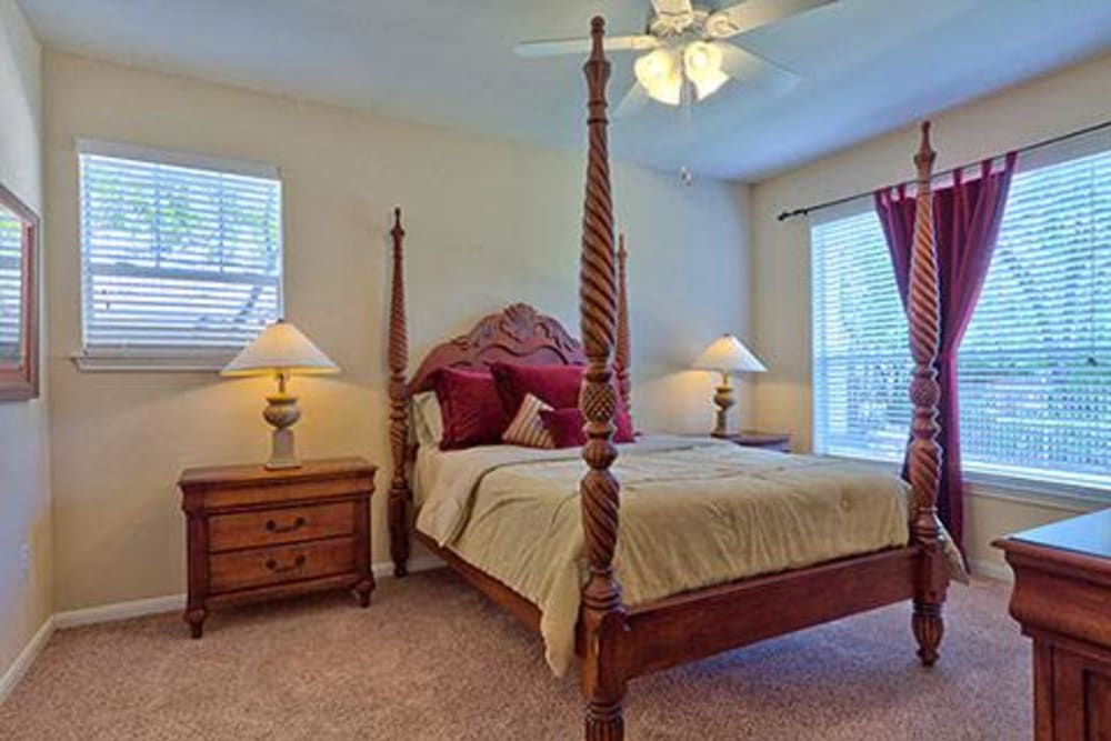 Well lit model bedroom at Somerset at Spring Creek in Plano, Texas