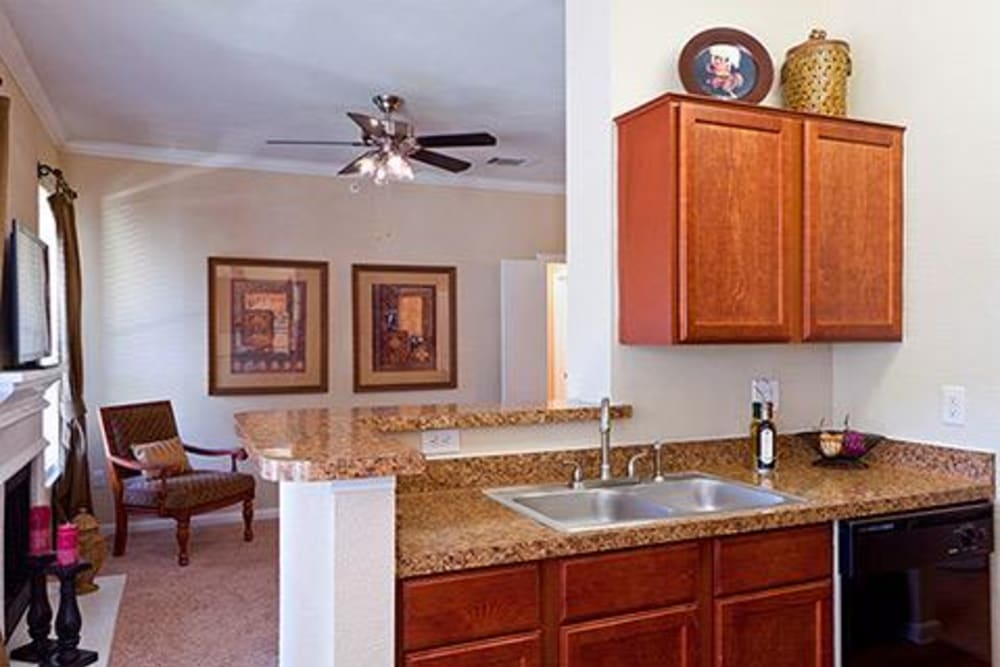 Kitchen overlooking living room at Somerset at Spring Creek in Plano, Texas