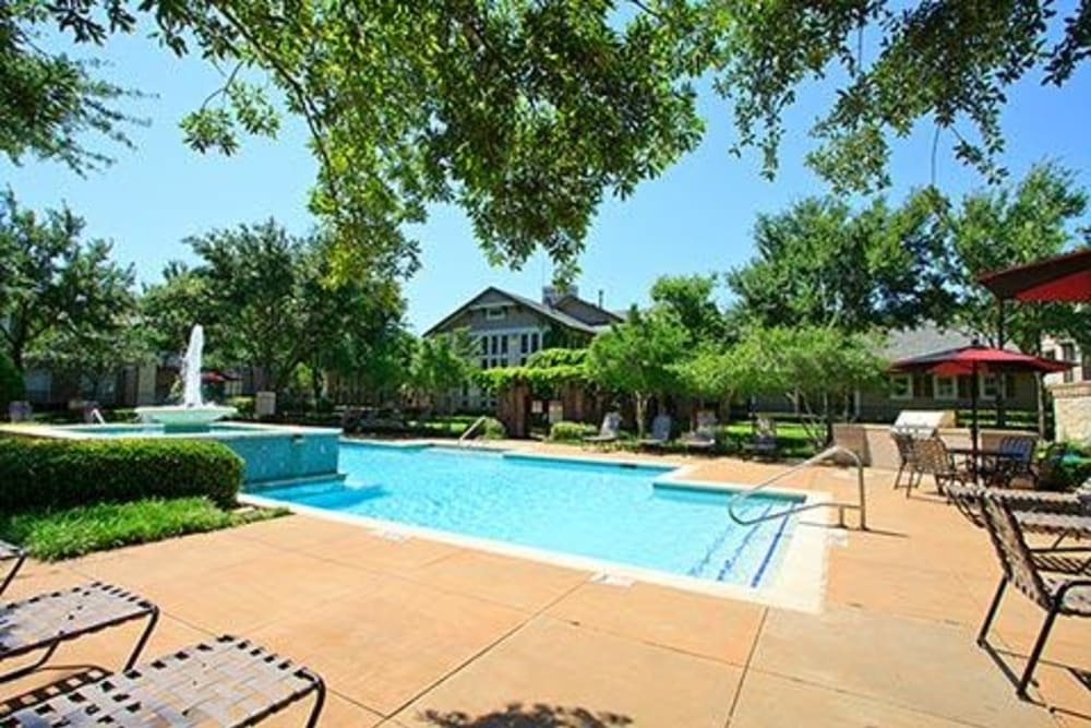 Lounge chairs poolside at Somerset at Spring Creek in Plano, Texas