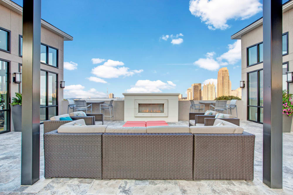 Outdoor lounge area with fireplace at Mark at West Midtown in Atlanta, GA