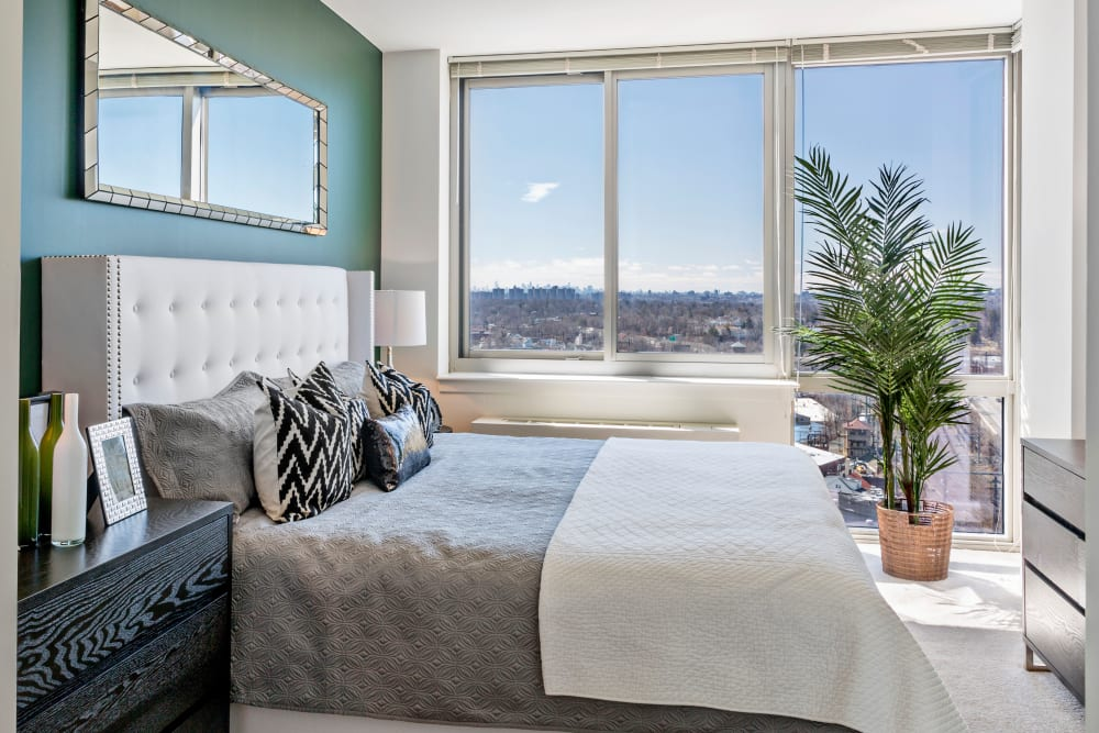 Well lit model bedroom with big windows at Skyline New Rochelle in New Rochelle, New York