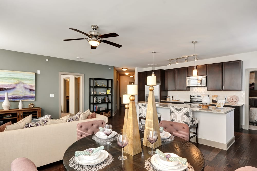 Open concept floor plan with hardwood floors in modern decor at The Mark at Brickyard Apartment Homes in Beltsville, Maryland