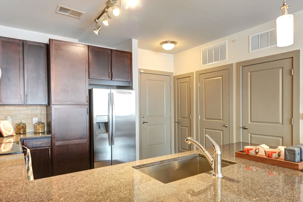 View of the unit kitchen from the bar at The Mark at Brickyard Apartment Homes in Beltsville, Maryland