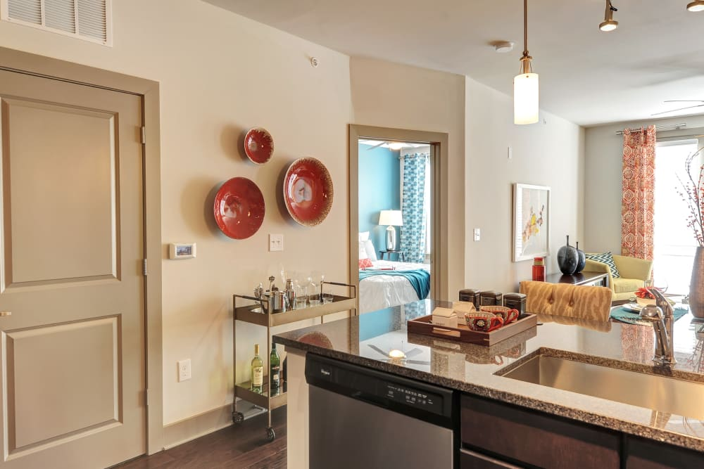 View of the dining area from the kitchen island at The Mark at Brickyard Apartment Homes in Beltsville, Maryland