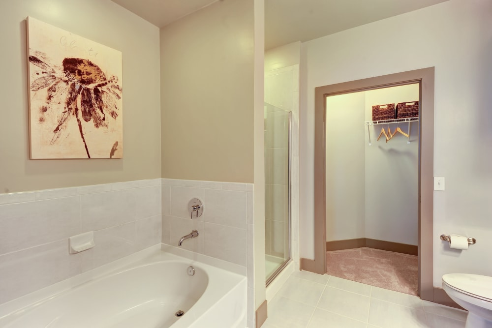 Model bathroom with a Jacuzzi style bathtub at The Mark at Brickyard Apartment Homes in Beltsville, Maryland