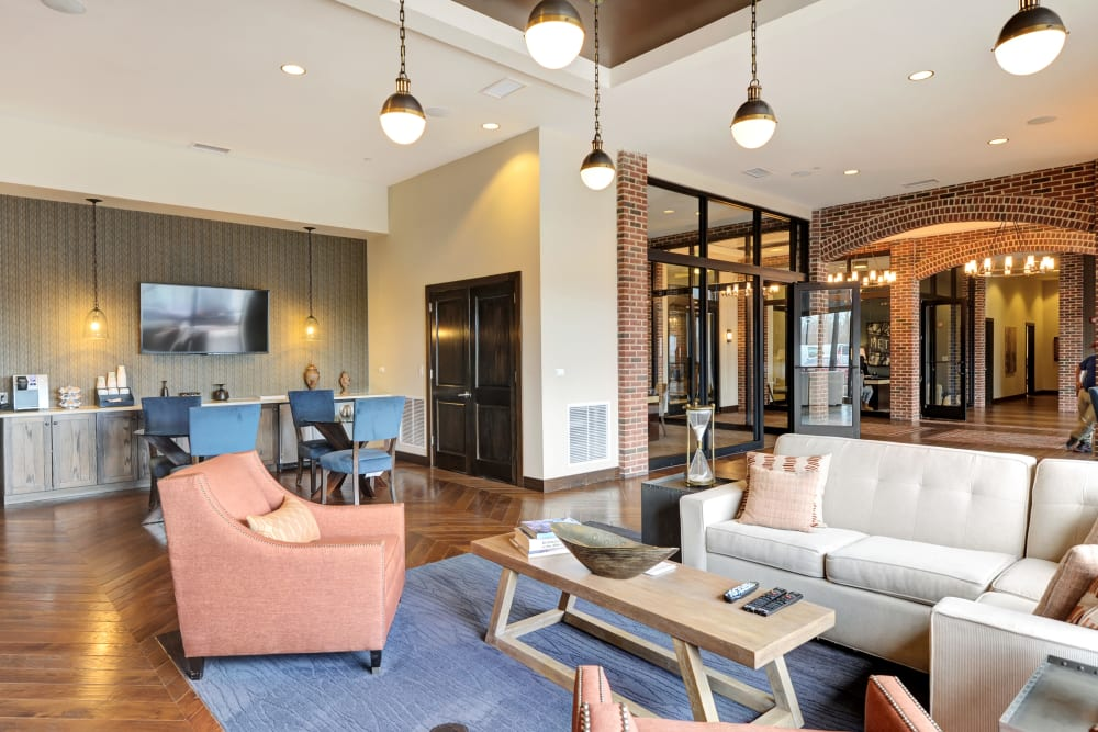 Clubhouse with plenty of seating and a coffee bar at The Mark at Brickyard Apartment Homes in Beltsville, Maryland