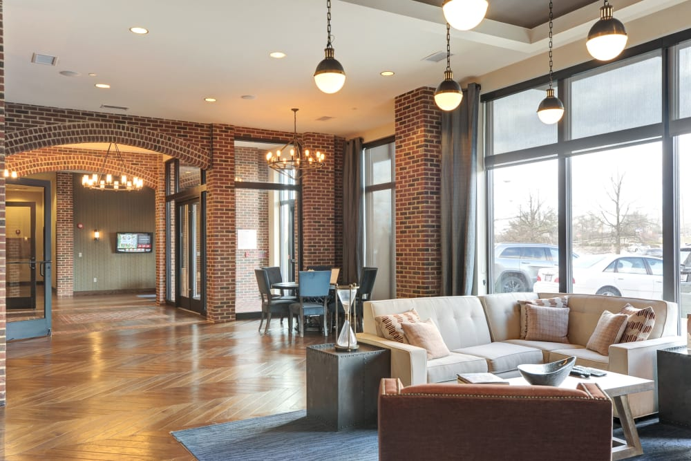 Lobby with modern decor and hardwood floors at The Mark at Brickyard Apartment Homes in Beltsville, Maryland