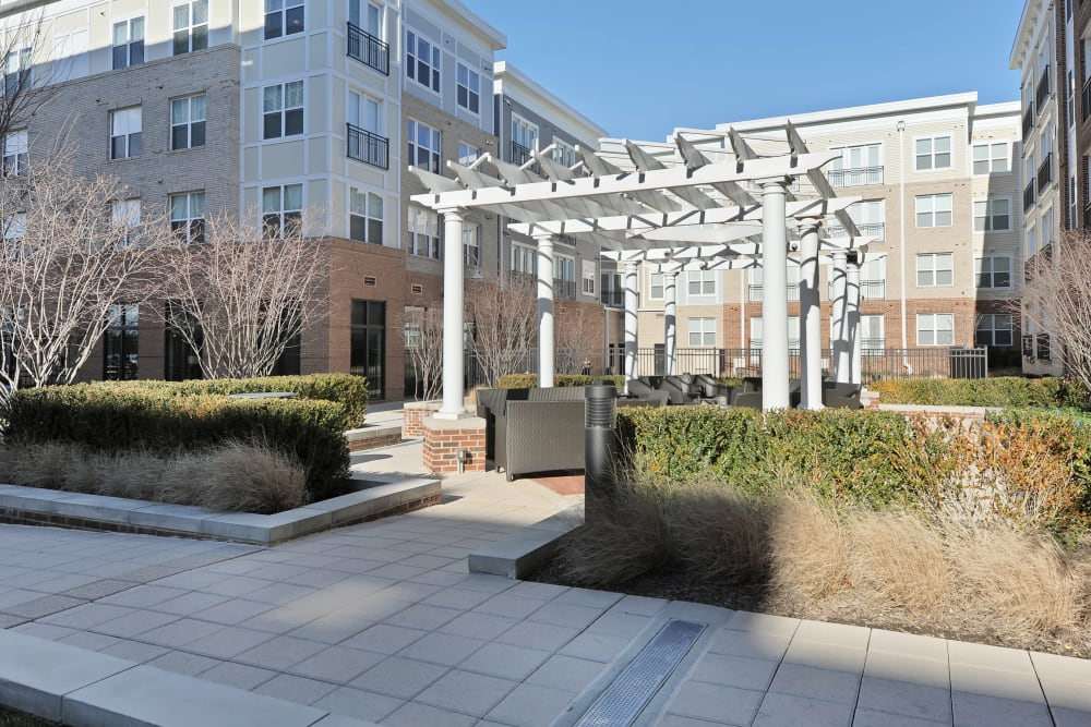 Outdoor barbecue and gazebo for residents at The Mark at Brickyard Apartment Homes in Beltsville, Maryland