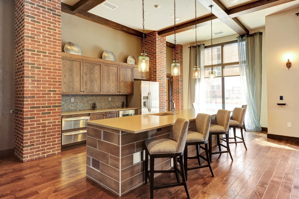 Bar seating at the kitchen in the clubhouse at The Mark at Brickyard Apartment Homes in Beltsville, Maryland