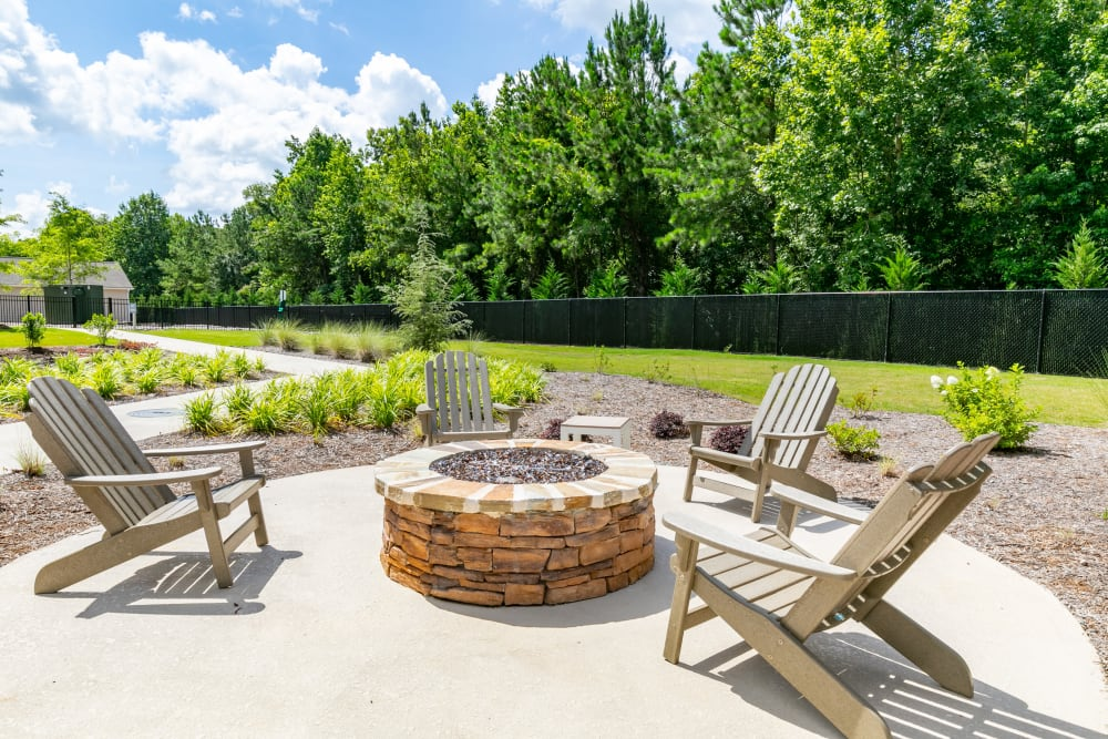 Fire pit and chairs at The Station at River Crossing in Macon, Georgia